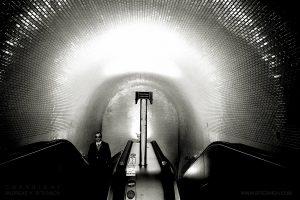Man ascending escalator, Lisbon 2019