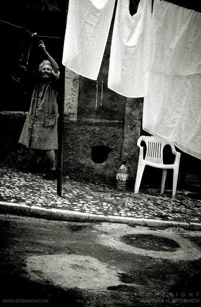 Woman hanging up laundry, Lisbon 2018