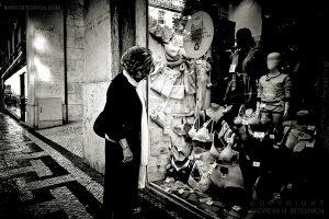 Woman in front of shop window, Lisbon 2019