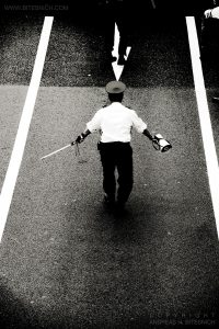 Arrow pointing at man, Tokyo, Japan 2012